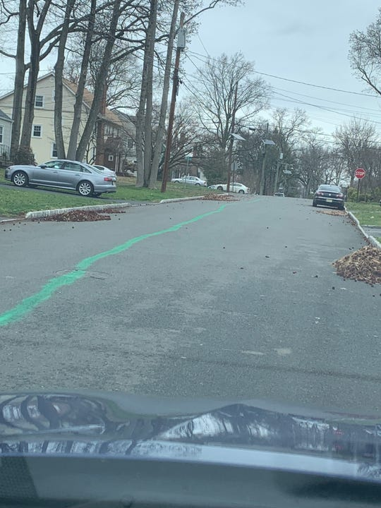 A green line forms a makeshift parade route for Mike Glackin's St. Patrick's Day performance in Scotch Plains.