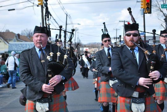 Mike Glackin, right, and his father, Matt, left perform with the St. Columcille United Gaelic Pipe Band during a Union County St. Patrick's Day Parade.