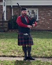Mike Glackin plays the bagpipes on the front lawn of his Cranford residence on St. Patrick's Day.