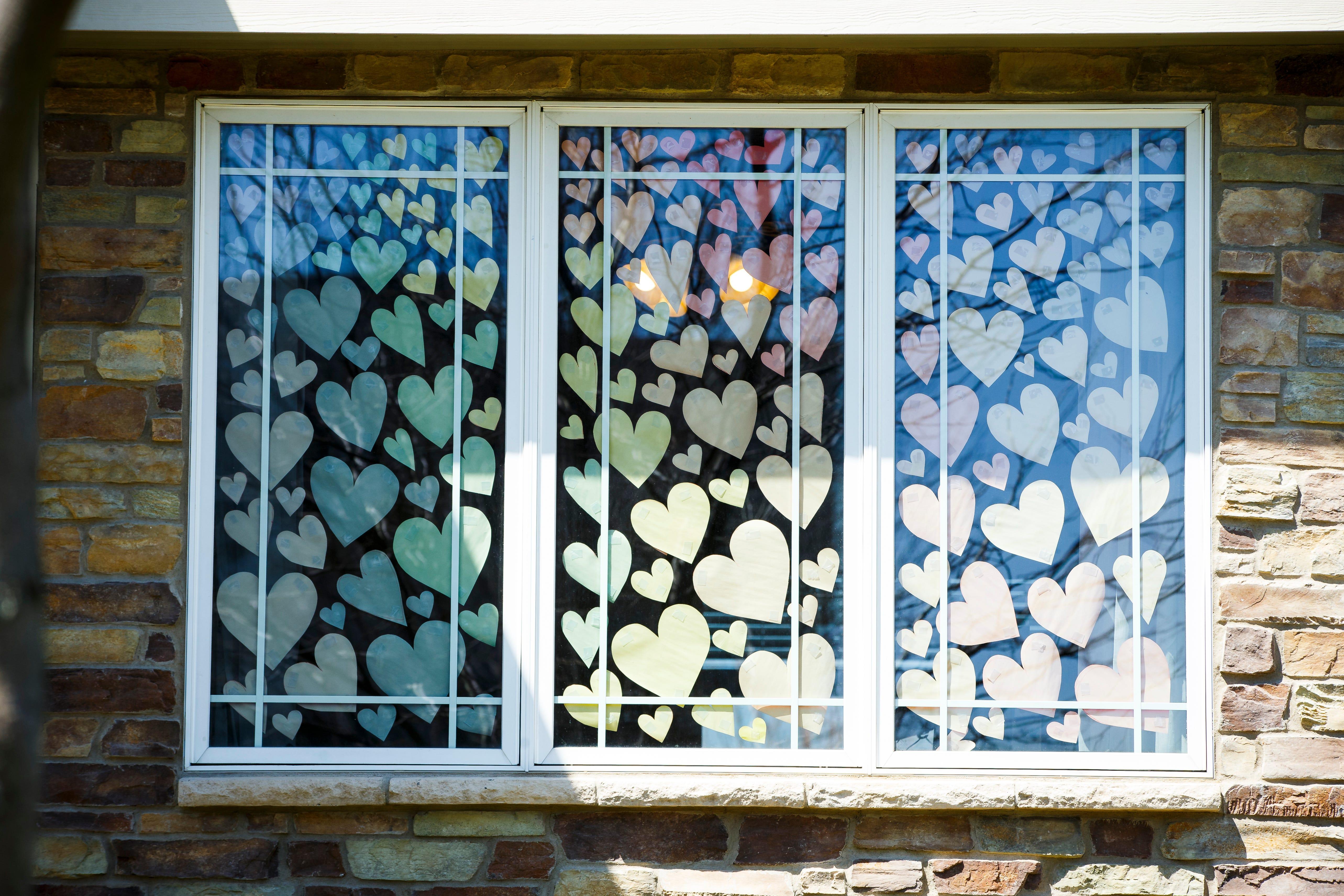 Paper hearts adorn a window
