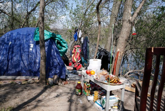 A homeless camp sits along the Des Moines River in Des Moines.