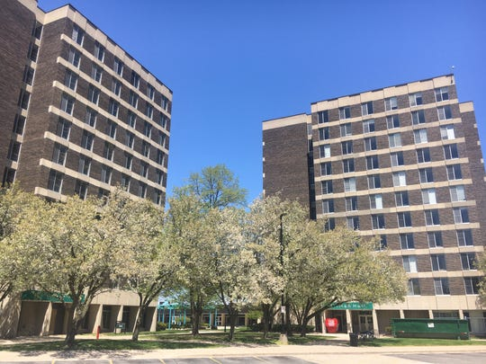 Two large, multi-story residence halls on the campus at Eastern Michigan University.
