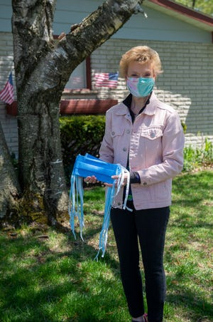 Maureen Abele of Livonia displays masks she made for health-care workers with materials supplied by St. Joseph Mercy Hospital.