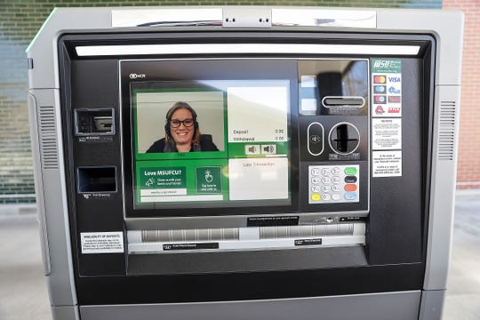Banking customers feel more comfortable with drive thrus and mobile banking during a time of social distancing. Keri Litner is a virtual bank teller that customers interact with at the interactive teller machine at Michigan State University Federal Credit Union in Berkley, Mich. photographed on Wednesday, May 13, 2020.