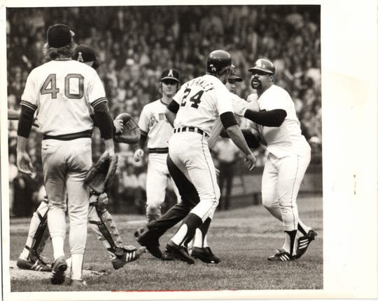 Tigers' Mickey Stanley steps between Willie Horton, right, and Angels' Frank Tanana (40) during the fourth inning of Game 1 of a doubleheader June 11, 1975 at Tiger Stadium. Benches cleared, Horton was ejected and action was halted for 20 minutes.