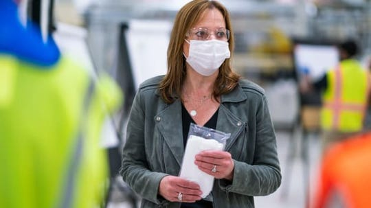 Mary Barra, CEO of General Motors,  tours one of the company's facilities in Warren, Michigan on April 1, 2020.