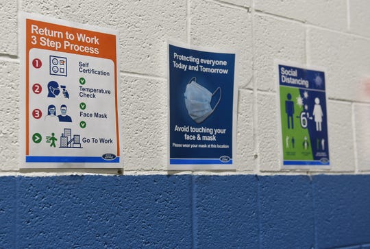 Signs are posted throughout the plant as a reminder to follow safe procedures at Ford's Rawsonville plant, where the automaker is making respirators, Wednesday, May 13, 2020.