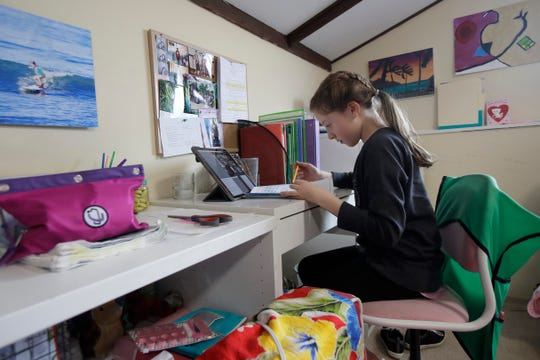 Rachel Keenan takes a live class online at her home in San Francisco. When students return to school after a lengthy pandemic-induced absence, the consensus is they will have lost significant academic ground.