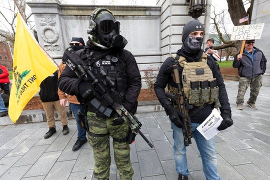 In this April 18, 2020, file photo, members of the boogaloo movement, attend a demonstration against the lockdown over concern about COVID-19 at the State House in Concord, N.H. It's a fringe movement with roots in a online meme culture steeped in irony and dark humor. But experts warn that the anti-government boogaloo movement has attracted a dangerous element of far-right extremists.