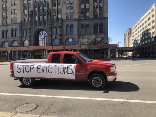 Vehicles adorned with signs calling for Gov. Gretchen Whitmer to extend a pandemic-related moratorium on evictions drove through Detroit on Wednesday, May 13, 2020.
