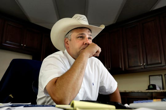 """Jason Glenn, co-manager of the Overland Stockyard auction house, says """"We've never seen anything like this. Not after 9/11. Not after the last financial downturn. Not ever."""" At the Overland Stockyard Auction House in Hanford, California, the day-long auction is done in sessions, one for choice feeder cattle, one online, and one for cattle going to slaughter. (Carolyn Cole/Los Angeles Times/TNS)"""
