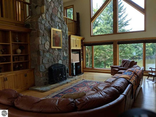 The main lodge has three bedrooms, three bathrooms and an expansive great room with an open floor plan with a split-rock fireplace.