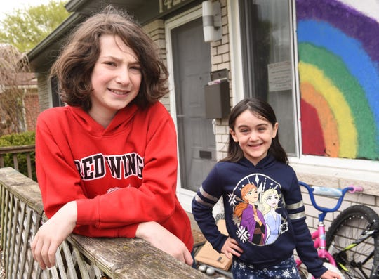 Shane Trelfa,13, and his sister Hope,7, pose on the front porch of their Oak Park home, Monday, May 11, 2020. Their mother Jori Trelfa wants to send her son to summer school this summer because he has benefited from the extra support in years before.