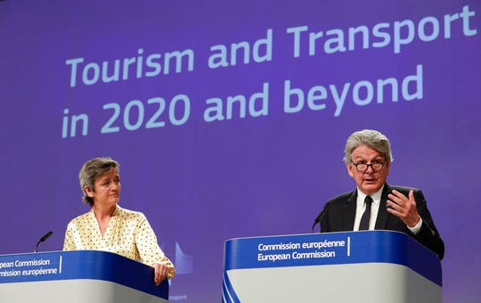 European Commission Vice-President Margrethe Vestager, left, and European Commissioner for the Internal Market Thierry Breton participate in a media conference regarding tourism at EU headquarters in Brussels, Wednesday, May 13, 2020.