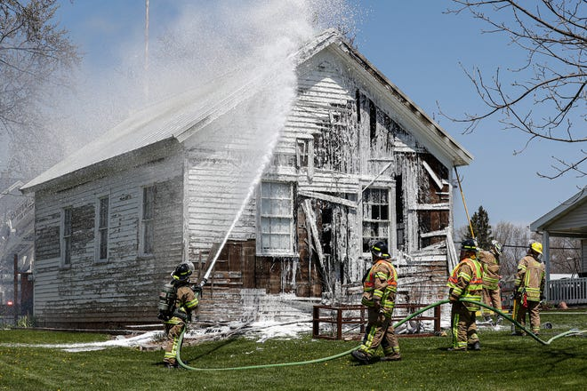 Firefighters battle a blaze Wednesday at the old town hall in Eden in the southern part of Fond du Lac County.