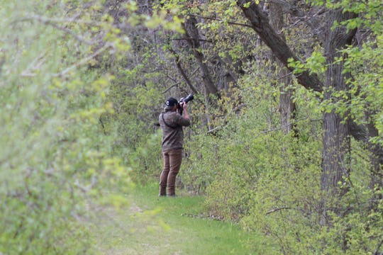 Despite cancellation of the Biggest Week in American Birding, birders like this one at the Ottawa National Wildlife Refuge on Tuesday are still coming to Ottawa County this week.