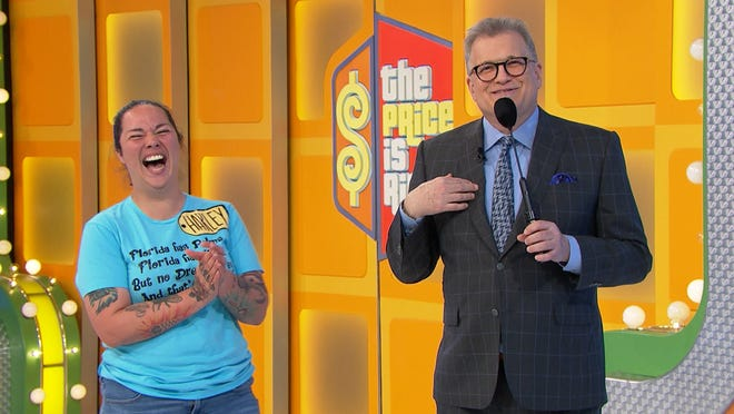 "Harley Engle laughs with host Drew Carey on Friday's episode of ""The Price Is Right."""
