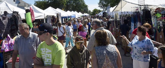 Visitors check out the Street Fair at a previous Shanty Days festival in Algoma. The 2020 Shanty Days is canceled because of uncertainty over the COVID-19 crisis..
