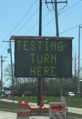 A sign on Lombardi Avenue points people to Brown County's COVID-19 test-collection site at the Resch Center.