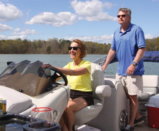 Christelle Orzan and Jim Rohrer enjoy a day on the water at Lake Hartwell.
