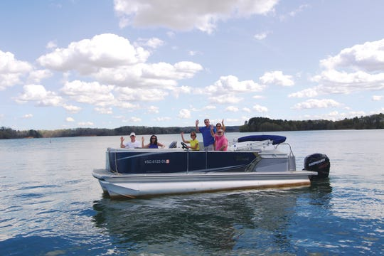 Christelle Orzan and Jim Rohrer with a group in a boat at Lake Hartwell.