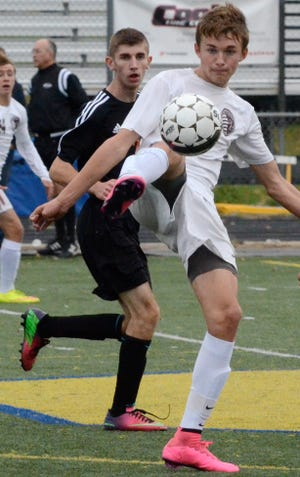 Michael Caron of Henderson County Colonels captures a high ball during the 2015 state soccer quarterfinal match with Fern Creek in Lexington.