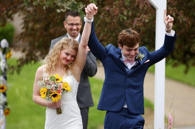 Chase and Sadie Smith celebrate after being married April 29, 2020.