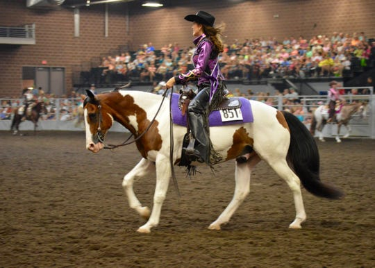 Maggie Dale is shown competing in the State Cowgirl Queen Contest with her horse Chaco at the Iowa State Fair.