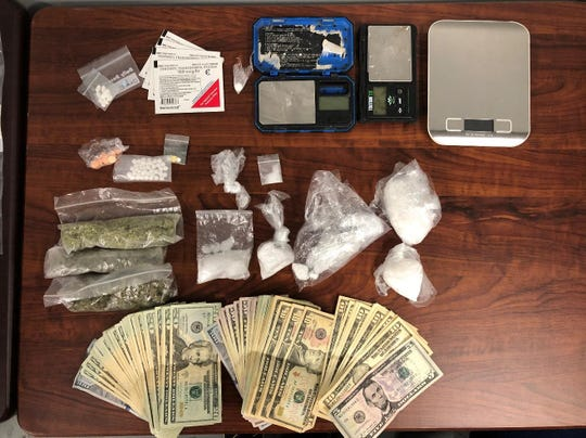 """During a search at 122 W Chestnut St, Apt 2B in Lancaster on Tuesday, the Fairfield-Hocking-Athens Major Crimes Unit recovered this evidence of drug trafficking, including scales and packaging materials, and a variety of pharmaceuticalpills packaged for sale, including Buprenorphine, Alprazolam, and Methadone. Officers also recovered MDMA """"Ecstasy"""", Transdermal Fentanyl patches, 40.7 grams of Marijuana, $2, 185.00 in US currency and approximately 114 grams of Methamphetamine."""