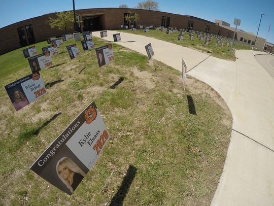Approximately 500 signs are displayed  Wednesday, May 13, 2020 in front of Brighton High School to commemorate the graduating class of 2020.