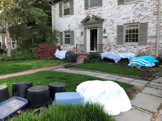 Paul Cappiello's front yard prepped for the recent spring freeze. The staff at Yew Dell Botanical Gardens, where Cappiello is director, held an informal, silliest looking front yard, competition.