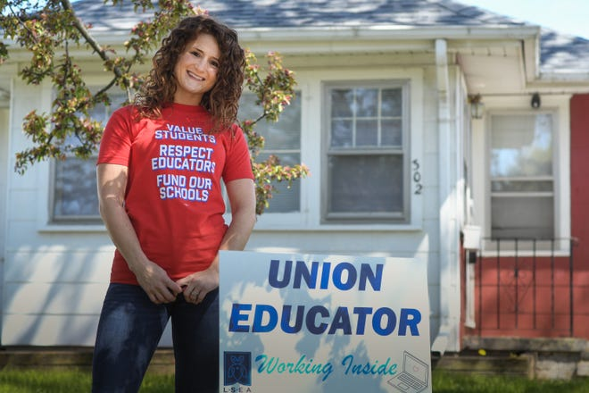 Sixth-grade teacher Mikaila Davis of Lansing poses for a portrait outside her home, Wednesday, May 13, 2020.  She has had to finish the school year teaching her students at Sheridan Road STEM remotely.