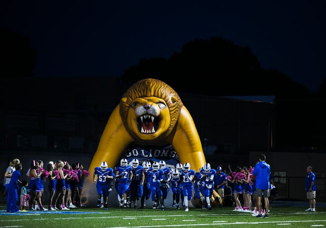 The Harding Academy football team enters the field for competition against FACS on Oct. 5, 2017. The school postponed athletics until Aug. 31 after reporting COVID-19 cases among its students and staff.