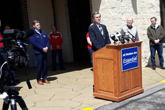 The Rev. Wayne Van Gelderen of Falls Baptist Church speaks at a news conference Wednesday, May 13, 2020, at Village Bowl in Menomonee Falls. Assembly Republicans, business owners and church leaders held the news conference to urge Gov. Tony Evers to reopen the state.