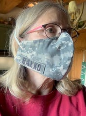 Erik Bakko made a mask for his mother, Katherine Bakko, out of one of his old Army uniforms. He has made a couple of dozen masks out of uniforms for family members and his co-workers at the William S. Middleton Memorial Veterans Hospital in Madison. Family photo