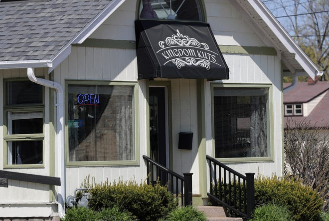 Kingdom Kuts remains open in defiance of Gov. Tony Evers' Safer at Home order Tuesday, May 12, 2020 in Appleton, Wis.