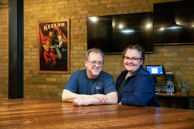 Chris Ragasis, left, and Jennifer Higgins, planned to open their 7-barrel brewery Wizard Works on April 1. Coronavirus and Safer at Home postponed that.