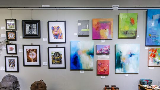 Colorful paintings by Menomonee Falls native, Noelle Stoffel, are just a few of the consignment items available at Purloin Studio in downtown Menomonee Falls on Wednesday, May 13, 2020. Many items are marked down as the art studio will be closing at the end of the month.