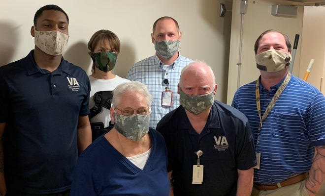 Erik Bakko has made unique face masks out of old military uniforms for his colleagues on the environmental management staff at the Madison VA Hospital. From left - Paris Allen-Saffold, Sara Johnson, Deb Shaw, Erik Bakko, Allen Huseth and Geoffrey Mongiat.