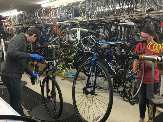 Employees at Allis Bike & Fitness in West Allis work on bikes that need a repair.  Much of this bike shops business  has been repairing bikes amid the cornavirus.