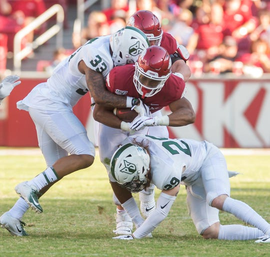 Arkansas running back Chase Hayden (2) is tackled by Portland State Vikings safety Ryan Lesch (29) and safety David Joseph (33) during the third quarter at Donald W. Reynolds Razorback Stadium last season.