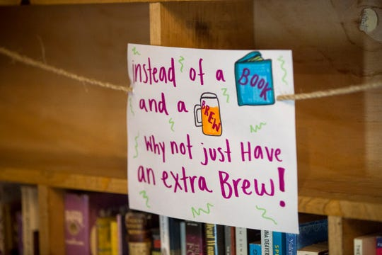 Signs denote that customers can't take books off the shelves of Books & Brews at the Muncie location. The change, while a divergence from the atmosphere and traditions of the business, were a precaution in the reopening of the state from the coronavirus pandemic.