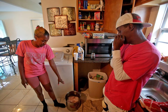 Nina Shelby-DuBose shows the last remaining chicken available in her kitchen in the Ninth Ward of New Orleans. She and her husband Shawn DuBose (R) are dealing with securing enough food for their large family with few grocery options in the neighborhood during the COVID-19 pandemic. Photographed on Saturday, May 9, 2020.