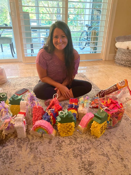 Erin Park, a fourth-grade teacher at Saint Ann Catholic School, stuffed mini pinatas full of candy to deliver to her students.