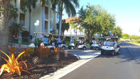 Staff of the Naples Lakes Country Club drove around 5 golf carts in the fashion of an ice cream truck to deliver treats to residents.