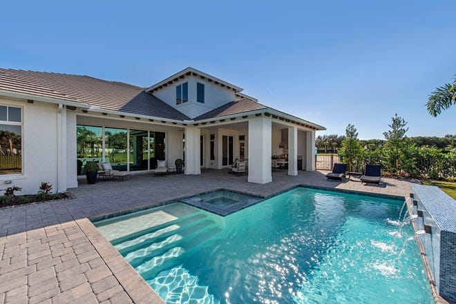 Families with little ones appreciate that every door or window opening to the swimming pool at a custom home in Enclave of Distinction, is hardwired to an alert system.