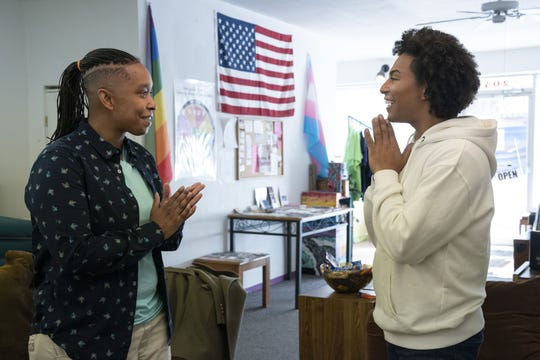 """From left, Nicole and drag queen Shangela Laquifa Wadley are pictured in February in Farmington during a scene from the HBO series, """"We're Here."""""""