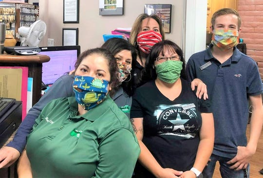 Staff at Sierra Blanca Pharmacy take time out of their busy schedules for a picture with their masks made by Project Facemask. From left are: Resa Mercado, Betsy Begay, Kassi Mcteigue, Micha Woodul and Brooks Egglestontouse.