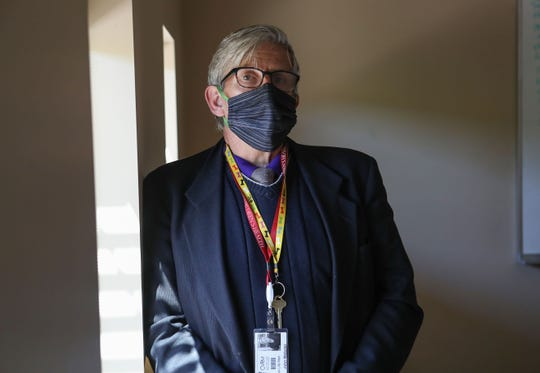 John Webster wears a facemask while living and working at the Coachella Valley Rescue Mission in Indio, April 16, 2020.
