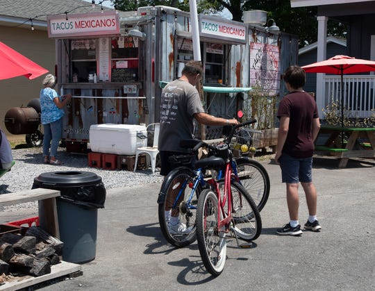 Customers line up at the Tacos Mexicanos food truck on 12th Avenue on Wednesday, May 13, 2020.  As a result of the COVID-19 pandemic, some restaurant owners are worried the nation's meat supply running low and driving up prices.